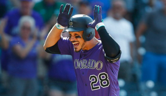 Colorado Rockies' Nolan Arenado celebrates as he circles the bases after hitting a walkoff, two-run home run off Arizona Diamondbacks relief pitcher Archie Bradley in the ninth inning of a baseball game in Denver. Arenado is at odds with the team's front office as the Rockies head to spring training for the season ahead.  Photo courtesy of David Zalubowski/AP