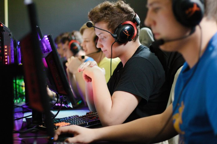 A group of people takes part in a video game competition. This week features an exciting collection of league action.  Photo courtesy of Anthony Brolin via Unspalsh