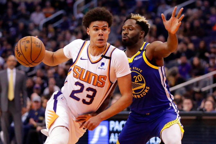 Phoenix Suns forward Cameron Johnson (23) drives as Golden State Warriors guard Jeremy Pargo (20) defends during the second half of an NBA basketball game, Wednesday, Feb. 12, 2020, in Phoenix. Photo by Matt York/AP