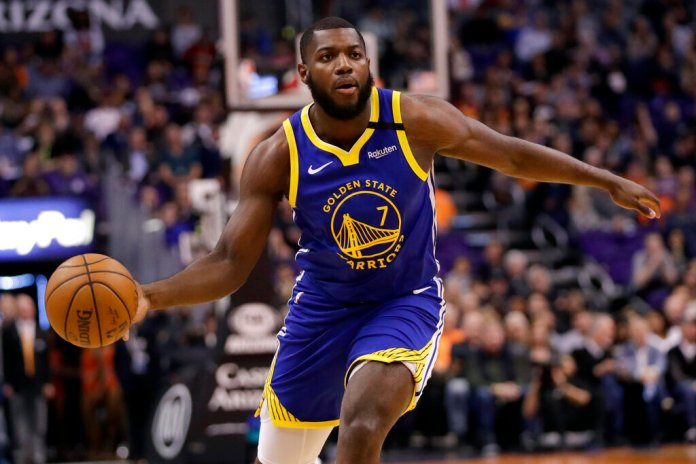 Golden State Warriors forward Eric Paschall (7) looks to pass against the Phoenix Suns during the first half of an NBA basketball game, Wednesday, Feb. 12, 2020, in Phoenix.  Photo by Matt York/AP