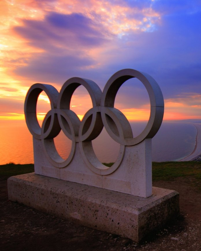 A photo of a monument of the Olympic Rings. 40 years ago the U.S.hockey team defeated the Soviet Union in the XIII Olympic Winter Games.   Photo by     Anthony     from     Pexels