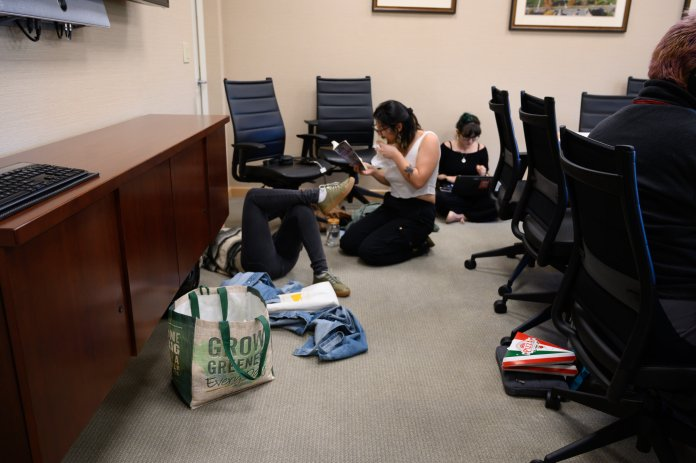 Members of the environmental activism group Fridays For Future stage a sit-in in Gulley Hall for the third week in a row on Friday, Oct. 18. They look to change their focus this semester.  Maggie Chafouleas/Daily Campus