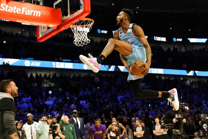 Miami Heat's Derrick Jones Jr. goes through his legs amidst a dunk in the NBA All-Star slam dunk contest in Chicago. Jones would go on to win a controversial finale over Aaron Gordon from the Orlando Magic.  Photo courtesy of Nam Y. Huh/AP