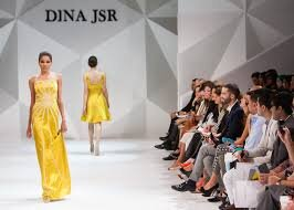Dina JSR brand fashion show from  PXHere . Walking around big cities,I'll see huge billboards and posters featuring the latest watch or shoe alongside a fierce face.