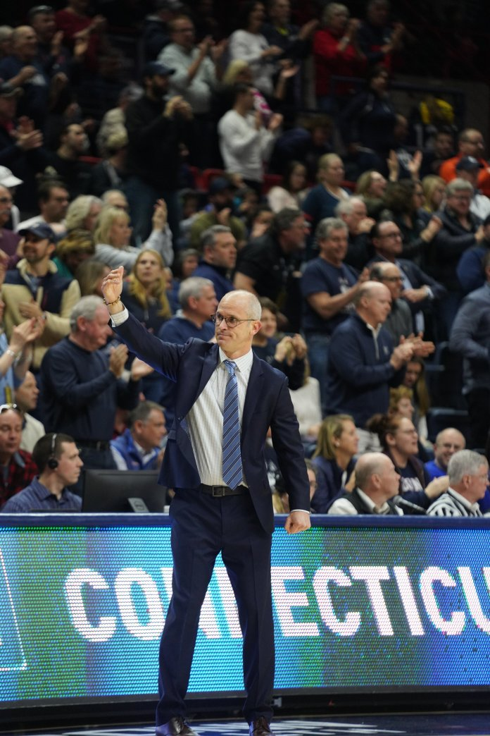 Dan Hurley eggs on the crowd as they scream UConn's patented chants on Big Red Day. Hurley has spoken multiple times on the impact the fans can have on the game.  Photo by Eric Wang/The Daily Campus.