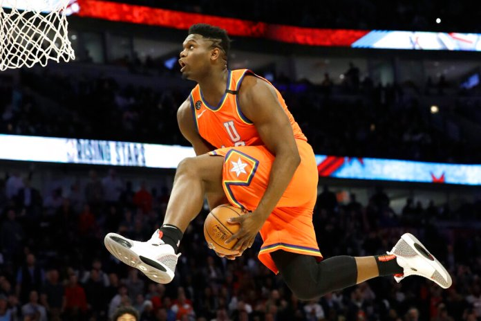 New Orleans Pelicans forward Zion Williamson, playing for the U.S. squad, goes up for a dunk during the second half of the NBA Rising Stars game in Chicago.  Photo courtesy of Nam Y. Huh/AP