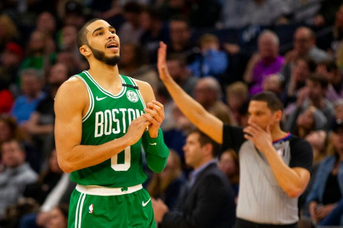 Boston Celtics forward Jayson Tatum celebrates after making a three-point basket against the Minnesota Timberwolves in the fourth quarter of a game Friday, in Minneapolis.  Photo courtesy of Andy Clayton-King/AP