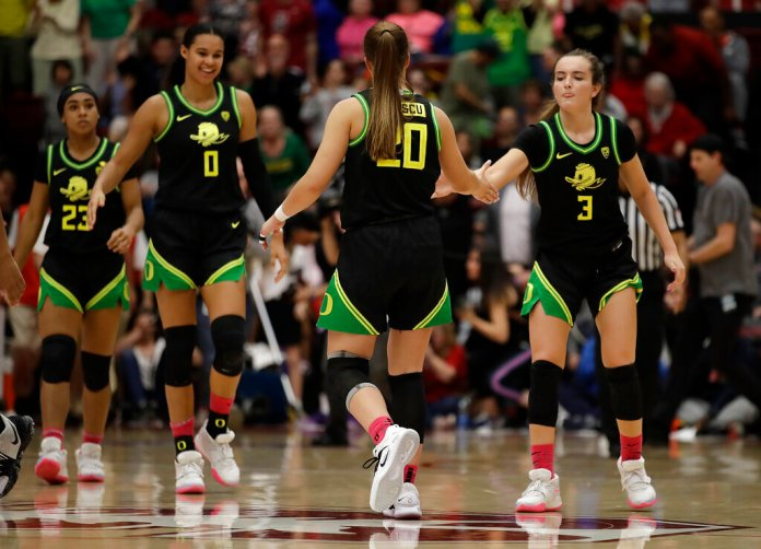 Oregon's Sabrina Ionescu is congratulated by teammates at the end of an NCAA college basketball game against Stanford Monday.  Photo courtesy of Ben Margot/AP