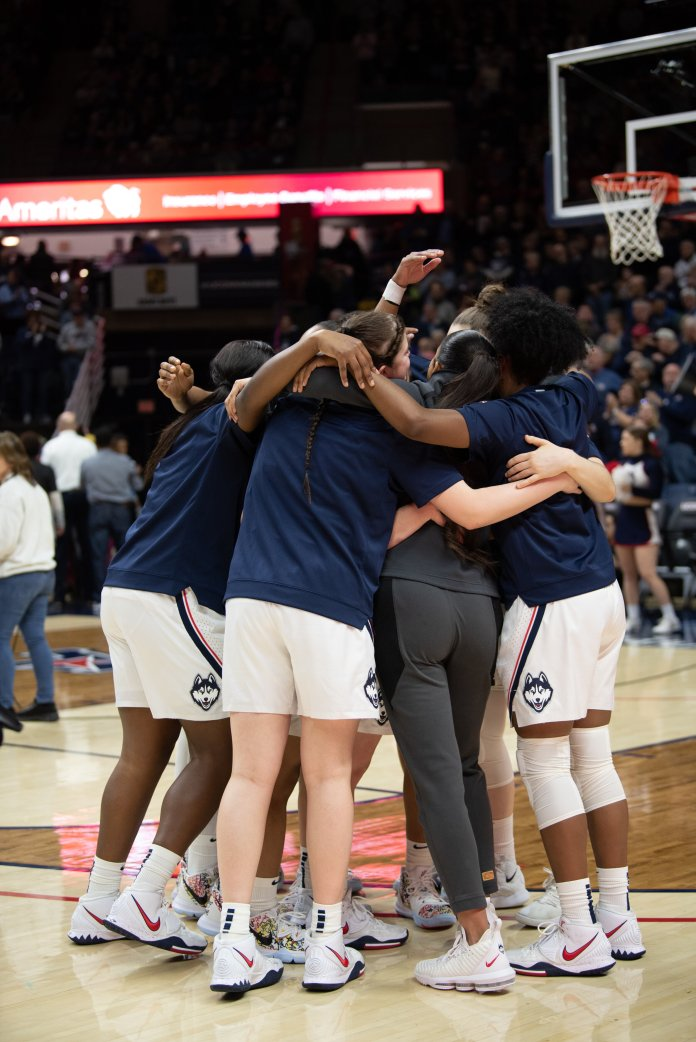 UConn gathers before their win over UCF Saturday. UConn saw four different players score double-digit points in their game against Cincinnati Wednesday.  Photo by Charlotte Lao/ The Daily Campus