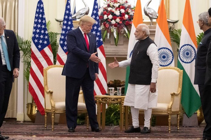 U.S. President Donald Trump and Indian Prime Minister Narendra Modi shake hands before their meeting at Hyderabad House, Tuesday, Feb. 25, 2020, in New Delhi, India. Trump was welcomed to India with a large rally. However, many protests also ensued, with some even turning deadly.  Photo courtesy of Alex Brandon / AP Photo.