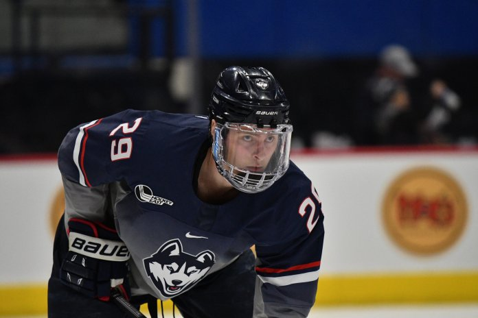UConn defeats BU in overtime Friday night in the XL Center. Senior Alexander Payusov scored the winning goal 19 seconds into sudden death OT. Goalkeeper Tomas Vomacka had a total of 23 saves, which helped UConn hold the Terriers scoreless during first period.  Photo by Kevin Lindstrom/The Daily Campus