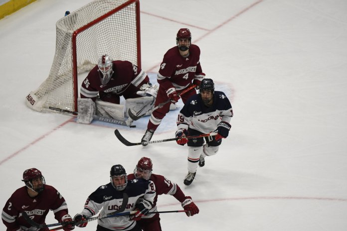 Friday night was Senior Night for the UConn men's hockey team. They made sure to celebrate by completing a comeback win against UMass in dramatic fashion, scoring the game-winner with just seven seconds left in the game.  Photo by Mike Mavredakis/The Daily Campus.