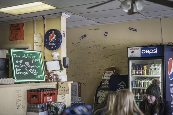 The Bagel Zone, a popular breakfast spot in Storrs, is covered in the signatures of UConn athletes. UConn march and signatures cover every available wall space inside.  Photo by Maggie Chafouleas/The Daily Campus