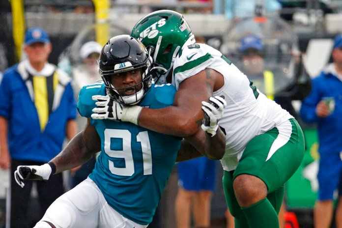 In this Oct. 27, 2019, file photo, Jacksonville Jaguars defensive end Yannick Ngakoue (91) rushes New York Jets offensive tackle Chuma Edoga during the first half of an NFL football game in Jacksonville, Fla.  Photo by Stephen B. Morton/AP