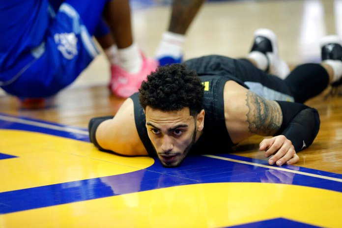 Marquette's Markus Howard reacts after being called for an offensive foul during the first half of a game against Seton Hall Saturday in Milwaukee.  Photo courtesy of Aaron Gash/AP