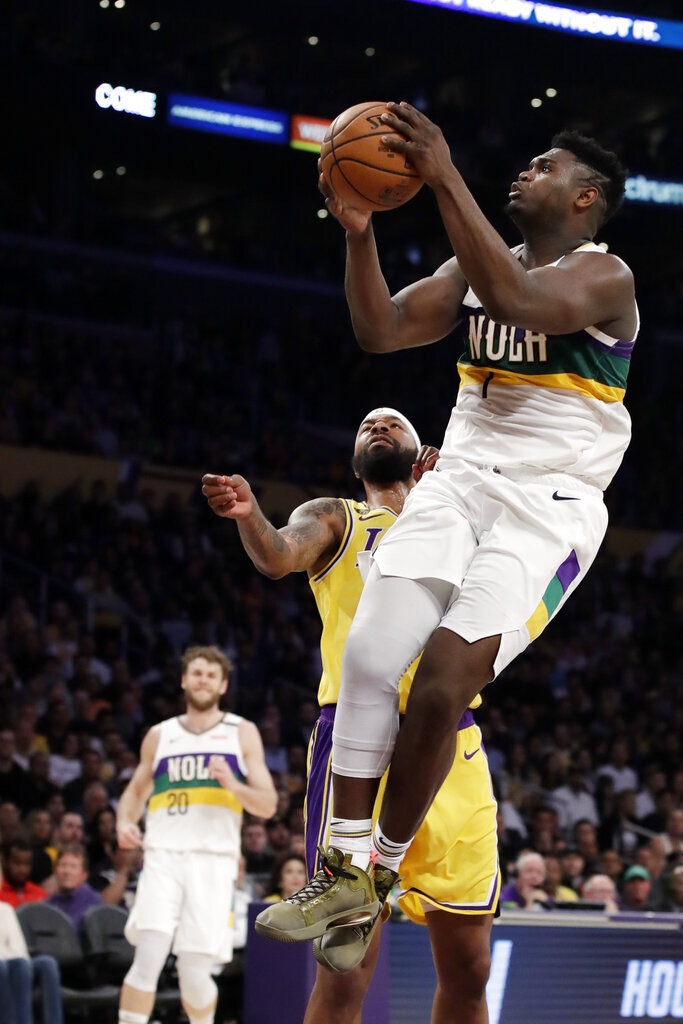 New Orleans Pelicans' Zion Williamson, right, drives past Los Angeles Lakers' Markieff Morris during the second half of a game Tuesday in Los Angeles.  Photo courtesy of Marcio Jose Sanchez/AP