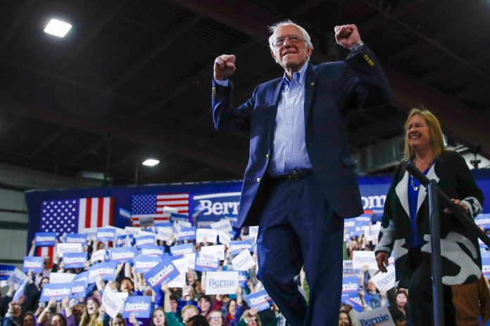 Democratic presidential candidate Sen. Bernie Sanders, I-Vt. arrives to speak during a primary night election rally in Essex Junction, Vt., Tuesday, March 3, 2020. After a competitive Super Tuesday showing, Biden is set to contend again down the stretch. It's now a two-man race. And the party is behind Biden.  Photo courtesy of Matt Rourke / AP Photo.