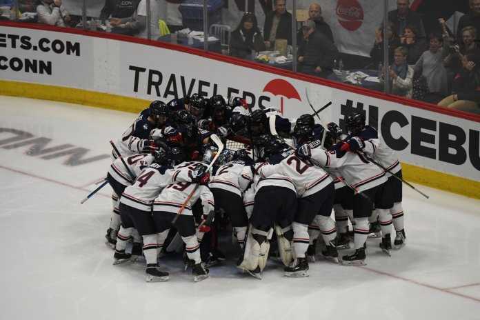 The UConn men's hockey huddling together before their late comeback win over No. 8 UMass last Friday.  Photo by Mike Mavredakis/The Daily Campus