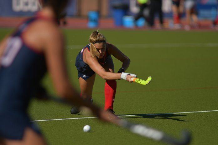 UConn field hockey's Abby Gooderham dribbles the ball.  Photo by Kevin Lindstrom/The Daily Campus