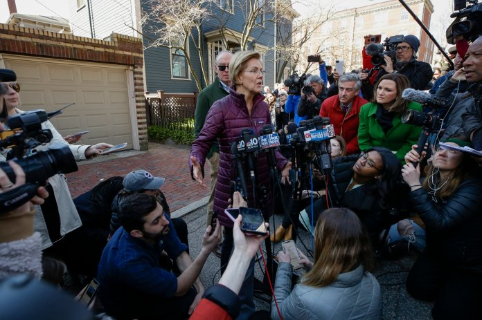 Sen. Elizabeth Warren, D-Mass., speaks to the media outside her home, Thursday, March 5, 2020, in Cambridge, Mass., after she dropped out of the Democratic presidential race.  Photo courtesy of Steven Senne / AP Photo.