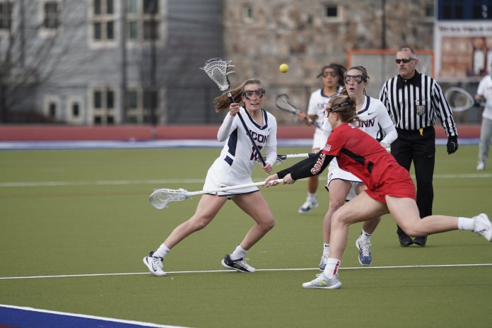 The Women's Lacrosse Team opened their season with a win against Fairfield University with a score of 19-12. Midfielder Sydney Watson (10) lead the team scoring 6 of 10 goals. Their next home game at the Sherman Family Complex is on 2/21 against UMass Lowell.  Photo by Eric Wang/The Daily Campus
