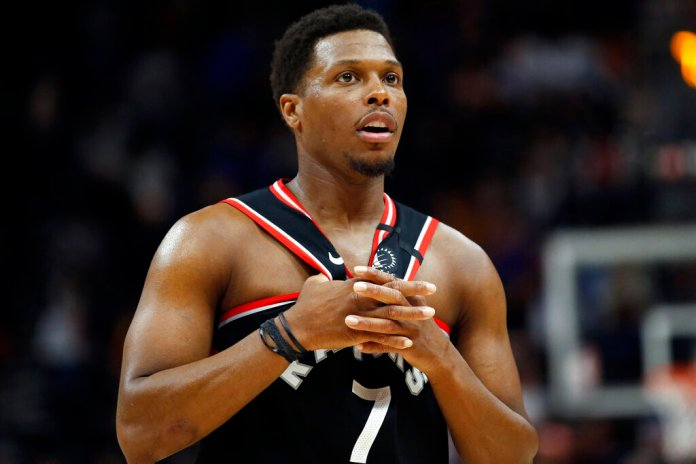 Toronto Raptors guard Kyle Lowry looks on in the second half of an NBA basketball game against the Utah Jazz, Monday, in Salt Lake City.  Photo by Rick Bowmer/AP