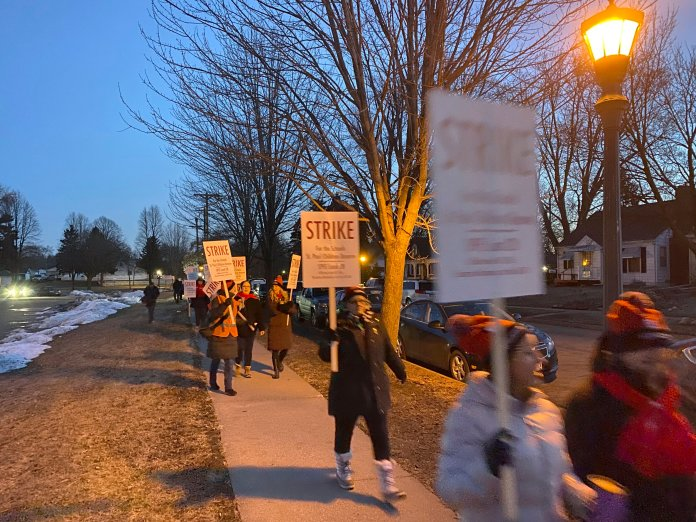 St. Paul teachers march during a strike early Tuesday, March 10, 2020, in St. Paul, Minn. Teachers at St. Paul Public Schools went on strike Tuesday after last-minute efforts to reach a contract agreement failed. (David Joles/Star Tribune via AP)