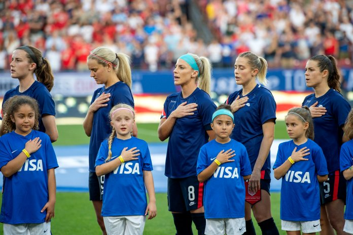 United States players Tierna Davidson, Lindsey Horan, Julie Ertz, Abby Dahlkemper, and Kelley O'Hara stand with their jerseys turned inside out during the playing of the national anthem before a SheBelieves Cup women's soccer match against Japan, Wednesday, March 11, 2020 at Toyota Stadium in Frisco, Texas. (AP Photo/Jeffrey McWhorter)