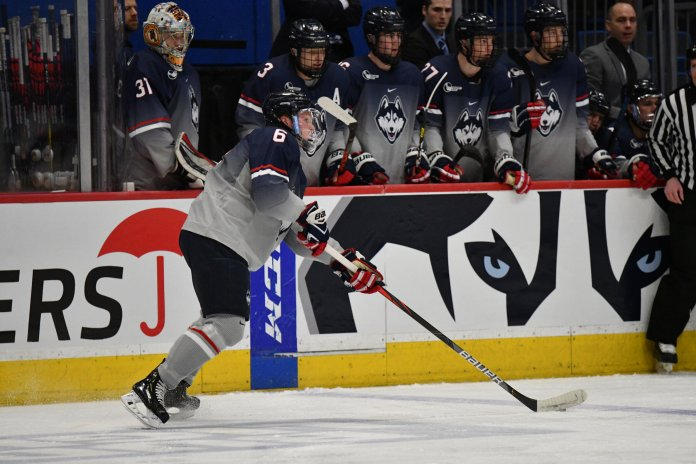 UConn defeats BU in overtime Friday night in the XL Center. Senior Alexander Payusov scored the winning goal 19 seconds into sudden death OT. Goalkeeper Tomas Vomacka had a total of 23 saves, which helped UConn hold the Terriers scoreless duing first period.  Photo by Kevin Lindstrom/The Daily Campus