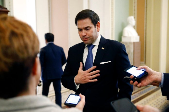 Sen. Marco Rubio, R-Fla., speaks with reporters on Capitol Hill in Washington, Tuesday, March 24, 2020, as the Senate works to pass a coronavirus relief bill.  Photo by Patrick Semansky/AP