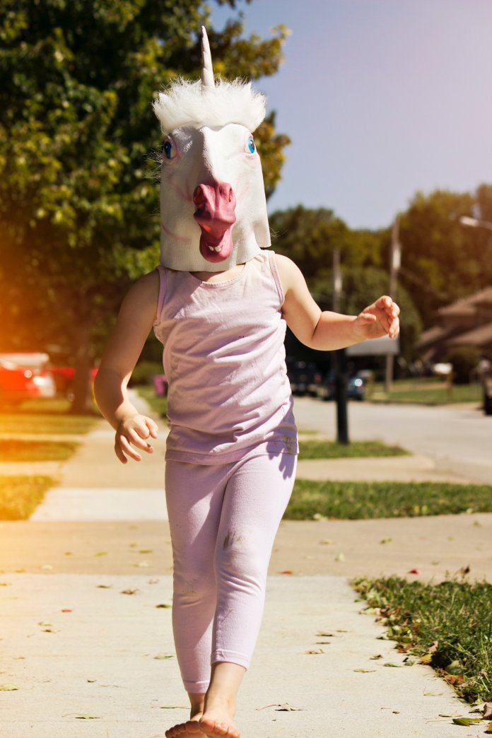 A photo of someone prancing around wearing a unicorn mask. 'Until Tomorrow' is the latest Instagram trend, where users post embarrassing photos of themselves.  Photo by    Andrea Tummons    on    Unsplash