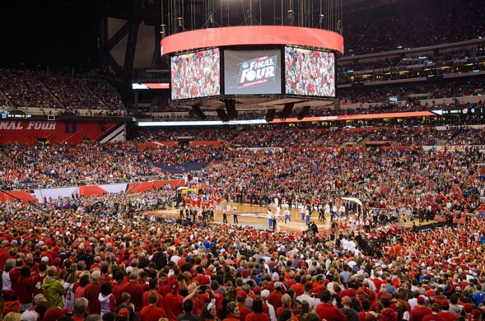Pregame warm-ups for the 2015 NCAA men's Division I basketball championship game between the Duke Blue Devils and Wisconsin Badgers at Lucas Oil Stadium in Indianapolis, Indiana.  Photo by Edward Blake in the    public domain