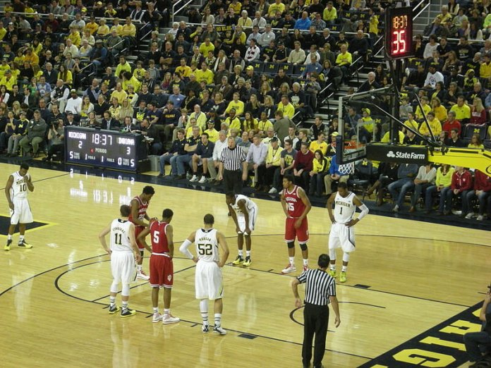 In-game action during the  Indiana Hoosiers  vs.  Michigan Wolverines  men's basketball game at  Crisler Center  in  Ann Arbor ,  Michigan  ( United States ). Michigan won 84–80.  Photo in the    public domain