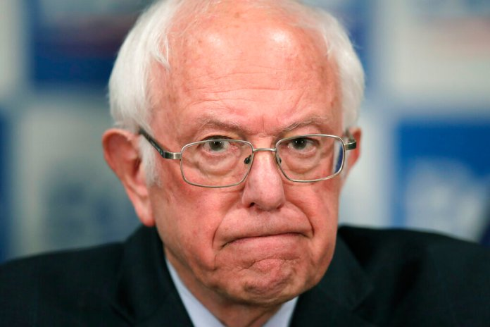 Democratic presidential candidate, Sen. Bernie Sanders, I-Vt., speaks to reporters about coronavirus in Burlington, Vt. Sanders announced today he is ending his campaign for president Wednesday.  Photo by Charles Krupa, File/AP