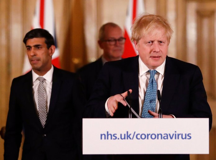 Britain's Chancellor Rishi Sunak, left, and Prime Minister Boris Johnson arrive for a press briefing about the ongoing situation with the COVID-19 coronavirus outbreak. With British Prime Minister Boris Johnson hospitalized and in intensive care Wednesday , after contracting the new coronavirus, Sunak is among key players in Johnson's Cabinet who will be directing Britain's response to the highly contagious COVID-19 coronavirus, while their leader is being treated.  Photo by Matt Dunham, FILE/AP