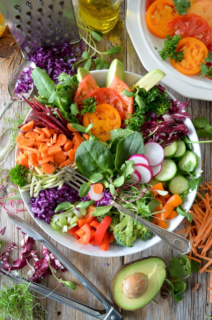 A healthy salad full of numerous different veggies. Eating healthier unprocessed foods can have a big impact on more than just your mood.  Photo by    Nadine Primeau    on    Unsplash
