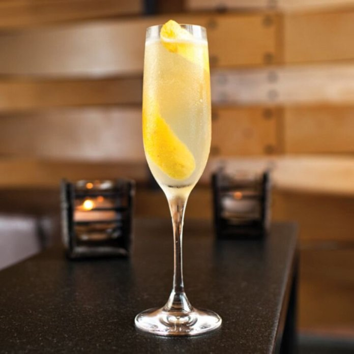 Transport yourself to the city of love by making a French 75 cocktail.  Photo courtesy of    liquor.com.