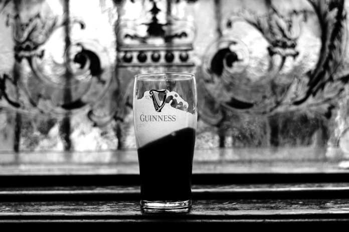 """Cap off your international """"bar crawl"""" with a pint of beer to celebrate Ireland.  Photo by    Sam Barber    on    Unsplash   ."""