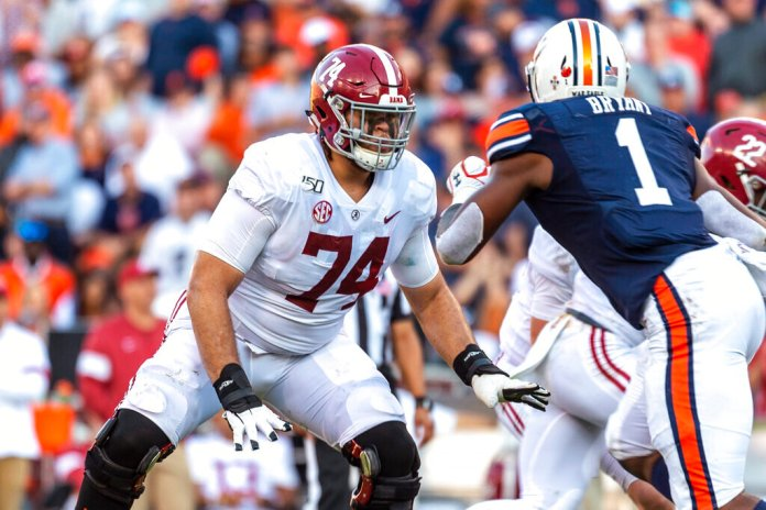 Alabama offensive lineman Jedrick Wills Jr. sets up to block against Auburn defensive lineman Big Kat Bryant during the first half of a game in Auburn, Ala. Wills is a likely first-round pick in the NFL draft Thursday.  Photo by Vasha Hunt, File/AP