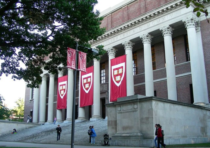 Rather than passing the time by sleeping or eating, consider taking a free online course at Harvard. It is sure to keep your mind busy while also learning valuable information from a top university in the country.  Photo via    commons.wikimedia.org