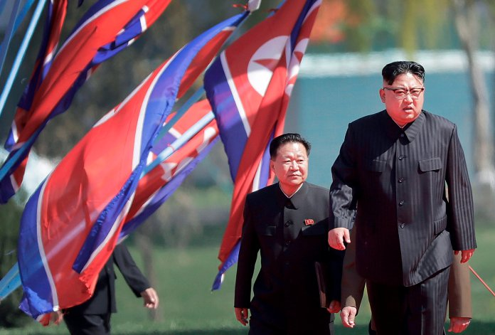 File photo of North Korean leader Kim Jong Un, right, and Choe Ryong Hae, vice-chairman of the central committee of the Workers' Party, arriving in Pyongyang, North Korea, 2017. Outside media speculates that leader Kim Jong Un may be unwell, there's uncertainty as to who will be next in line.  Photo by Wong Maye-E / AP Photo.