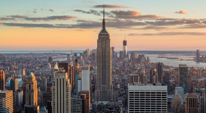 The Empire State Building has served as the centerpiece of New York for nearly 100 years. It began as a competition to see who could build the tallest building and ended with one of the most iconic skyscrapers in the world.  Photo via    wikipedia.org