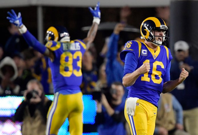 In this Jan. 12, 2019, file photo, Los Angeles Rams quarterback Jared Goff celebrates after a touchdown by running back C.J. Anderson during the second half in an NFL divisional football playoff game against the Dallas Cowboys in Los Angeles. A year ago at this time, the Los Angeles Rams were fresh off a Super Bowl trip and back-to-back NFC West titles. Now they seem to be looking up at the competition in the NFL's toughest division. (AP Photo/Mark J. Terrill, File)