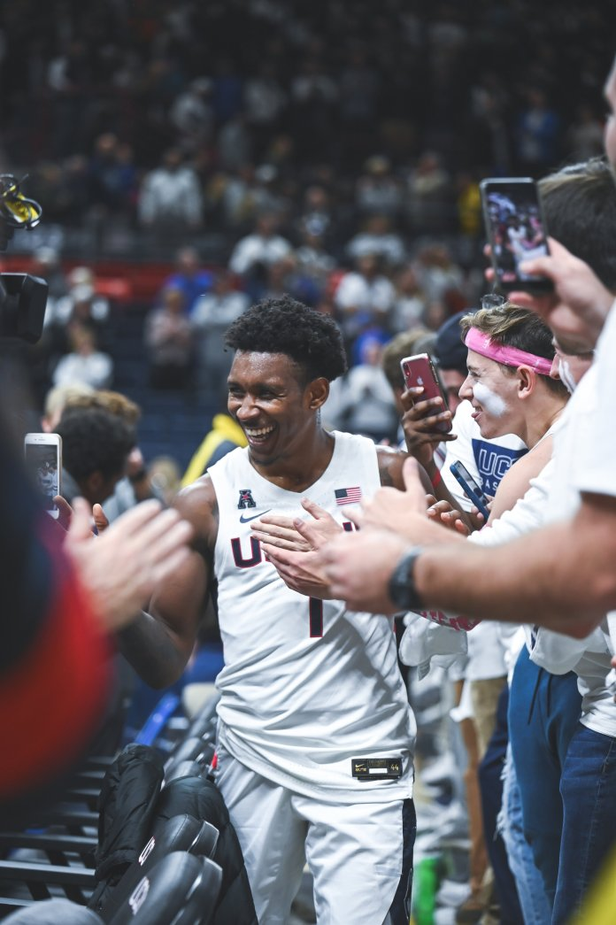UConn men's basketball's Christian Vital high-fives the student section fans after a win over No. 15 Florida in December.  Photo by Charlotte Lao/The Daily Campus