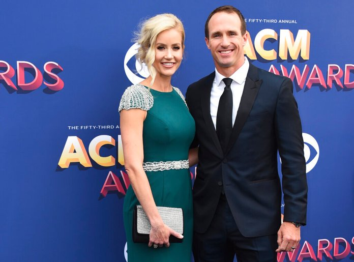 In this April 15, 2018 file photo, Brittany and Drew Brees arrive at the 53rd annual Academy of Country Music Awards at the MGM Grand Garden Arena in Las Vegas. Photo by Jordan Strauss/AP
