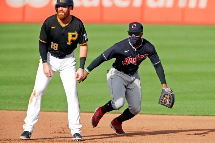 Cleveland Indians shortstop Francisco Lindor, right, holds Pittsburgh Pirates' Colin Moran (19) on second during the fifth inning of an exhibition baseball game in Pittsburgh, Wednesday, July 22, 2020. The Indians won 5-3.  Photo by Gene J. Puskar/AP