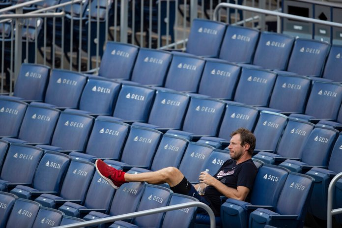 Washington Nationals starting pitcher Max Scherzer watches from the stands at Nationals Park during the baseball team's intrasquad game Wednesday, July 15, 2020, in Washington.  Photo by Alex Brandon/AP