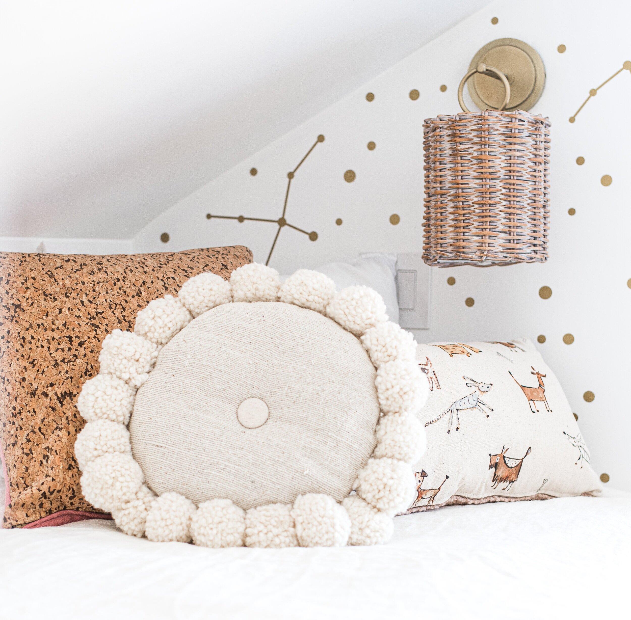 make round pillow with pom poms