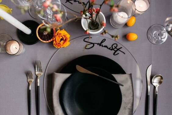 Wedding plate chargers as the new place card? Yes, please! We're especially fond of this custom acrylic and calligraphy wedding charger plate from Love Fern Design Studio . Planning and coordination by Bright Side Events , Brittney Hyatt Photography
