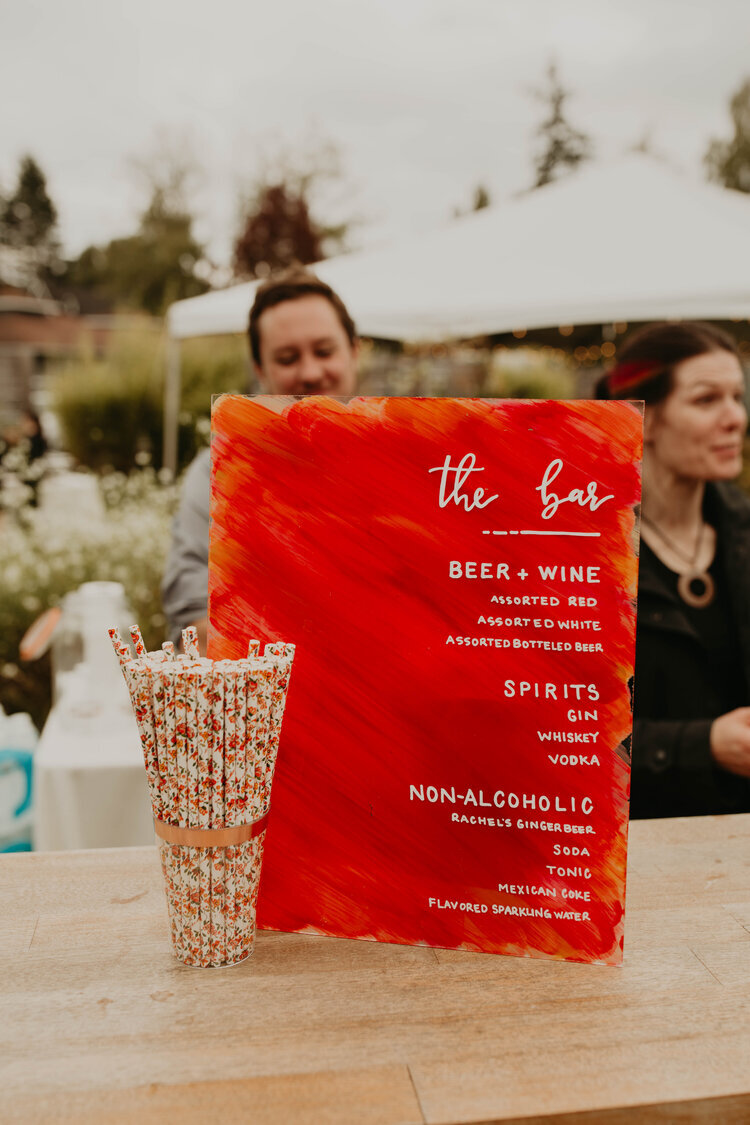 Get creative with your bar wedding sign like Love Fern Design Studio did featuring the couples red wedding accent color while letting your wedding guests know what's on tap. Planning and coordination by Flying Anchor Event Design , Marnie Cornell Photography